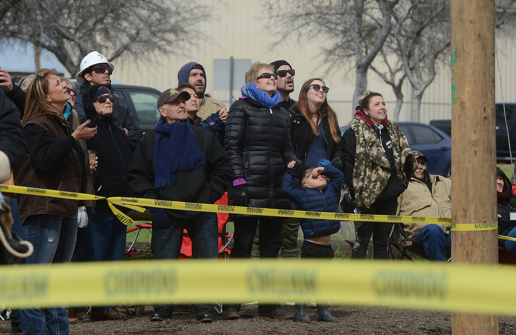 . The crowd watches graduates race up poles during Northwest Lineman College\'s graduation rodeo, March 15, 2018, in Chico, California. (Carin Dorghalli -- Enterprise-Record)