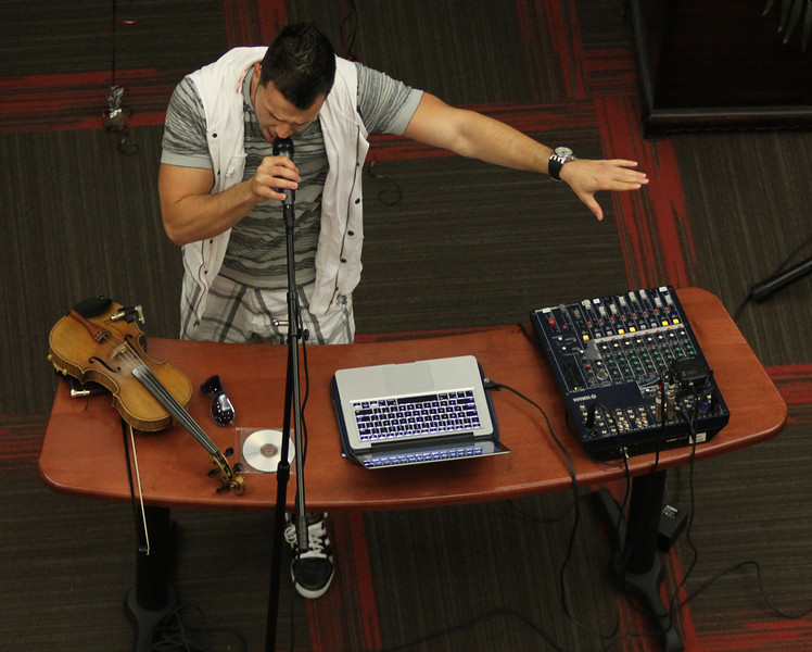 Bulgarian hip-hop violinist Svet sings during his performance for GWU in the Tucker Student Center on September 27.