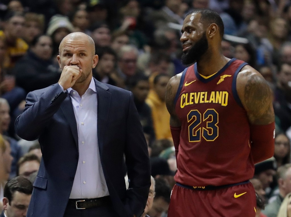 . Milwaukee Bucks head coach Jason Kidd talks to Cleveland Cavaliers\' LeBron James during the first half of an NBA basketball game Tuesday, Dec. 19, 2017, in Milwaukee. (AP Photo/Morry Gash)