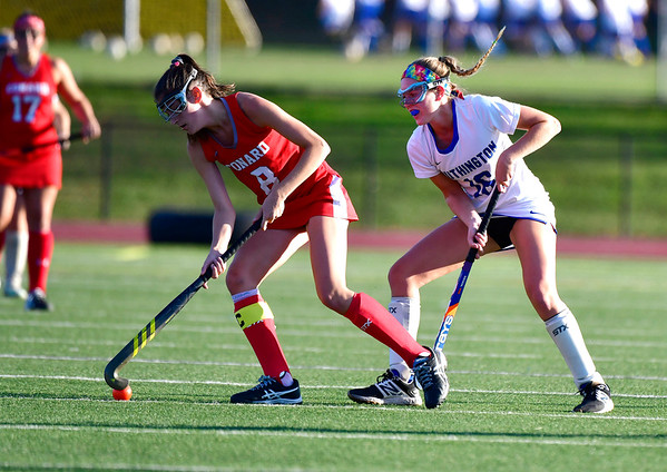 10/15/2019 Mike Orazzi | StaffrConard High Schools Caroline Kumpa r(8) and Southington's Kelsey Henderson r(12) during a 2-2 tie in field hockey action at Southington High School in Southington on Tuesday afternoon.