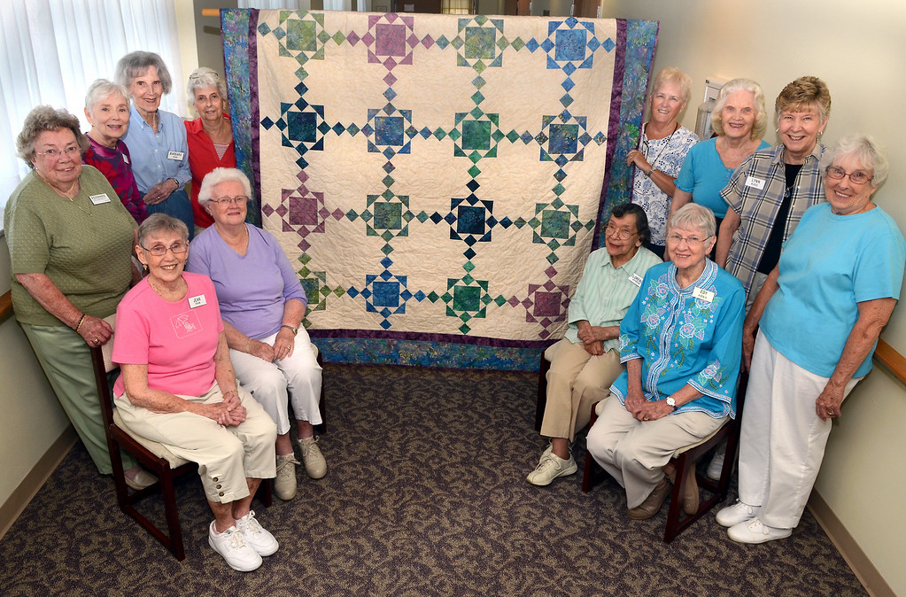 . Brittany Pointe Quilters (L-R top)Rosemary Dougherty,Nora O\'Malley,Barbara Kerr,Jennie Barratt,Virginia Altman,Lois Burns,Lynn Nurse and Pat Wilson, (L-R seated)Jean Shaw,Helen Lindquist,Florence Johnson and Edy Koenig with the quilt they made for the raffel in November . Photo by Mark C Psoras/The Reporter