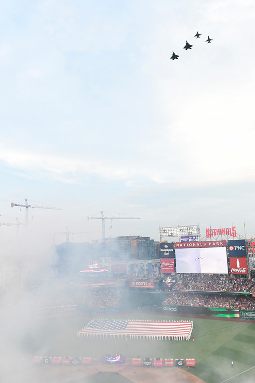 . U.S. military aircraft flyover the stadium before the MLB Home Run Derby, at Nationals Park, Monday, July 16, 2018 in Washington. The 89th MLB baseball All-Star Game will be played Tuesday. (AP Photo/Susan Walsh)