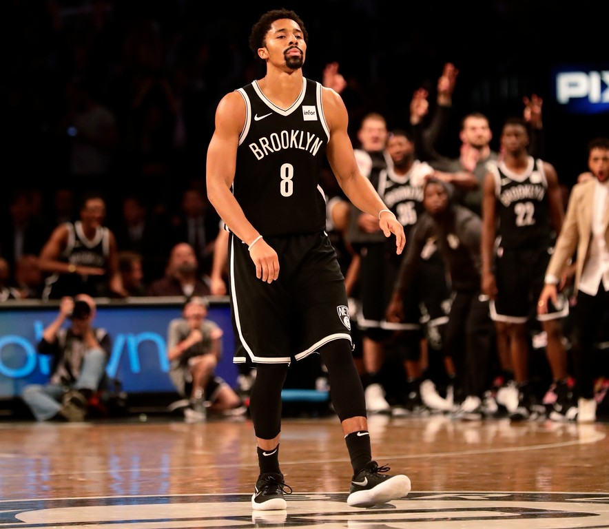 . Brooklyn Nets\' Spencer Dinwiddie (8) reacts as his teammates celebrate after Dinwiddie made a three point basket during the second half of an NBA basketball game against the Cleveland Cavaliers Wednesday, Oct. 25, 2017, in New York. The Nets won 112-107. (AP Photo/Frank Franklin II)