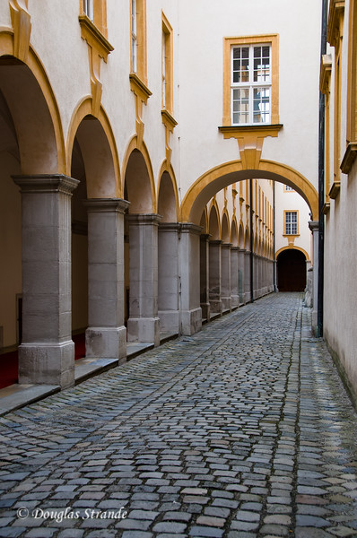 Cobblestone walk and arches at Melk Abbey