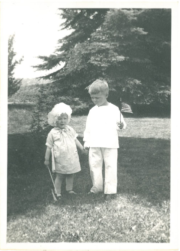 "Description of . Writes LORRAINE of Roseville: ""This is a picture of my brother and me on Memorial Day 1928 at our grandparents' farm in St. Peter. My brother, Ken Skoog of New Brighton, was 5 years old, and I was 2. (He was concerned that I wasn't holding my flag up straight.) He is turning 90 on May 28th, and I thought this picture would be a fun surprise for him. Happy Birthday, Ken!"""