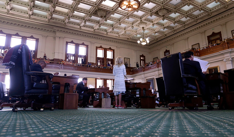 . Sen. Wendy Davis, D-Fort Worth, center, speaks as she begins a filibusters in an effort to kill an abortion bill, Tuesday, June 25, 2013, in Austin, Texas. The bill would ban abortion after 20 weeks of pregnancy and force many clinics that perform the procedure to upgrade their facilities and be classified as ambulatory surgical centers.  (AP Photo/Eric Gay)