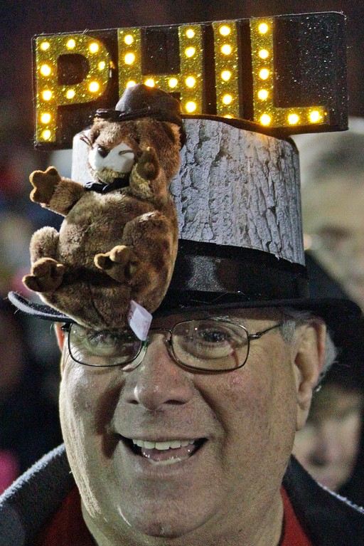 . Fred Unger of York, Pa., waits in the early morning of Feb. 2, 2012 on Gobbler\'s Knob for weather prognosticating groundhog Punxsutawney Phil to appear, during the 126th celebration of Groundhog Day in Punxsutawney, Pa. (AP Photo/Gene J. Puskar)