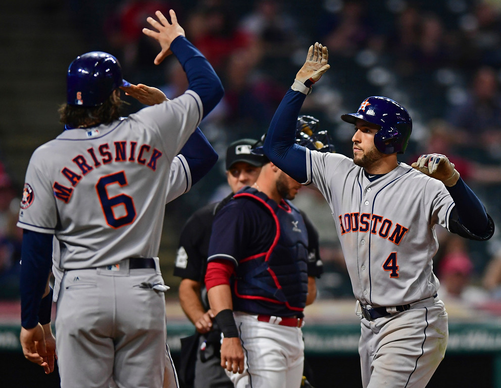 . Houston Astros\' George Springer, right, celebrates with Jake Marisnick after hitting a three-run home run off Cleveland Indians relief pitcher Josh Tomlin during the ninth inning of a baseball game Friday, May 25, 2018, in Cleveland. The Astros won 11-2. (AP Photo/David Dermer)
