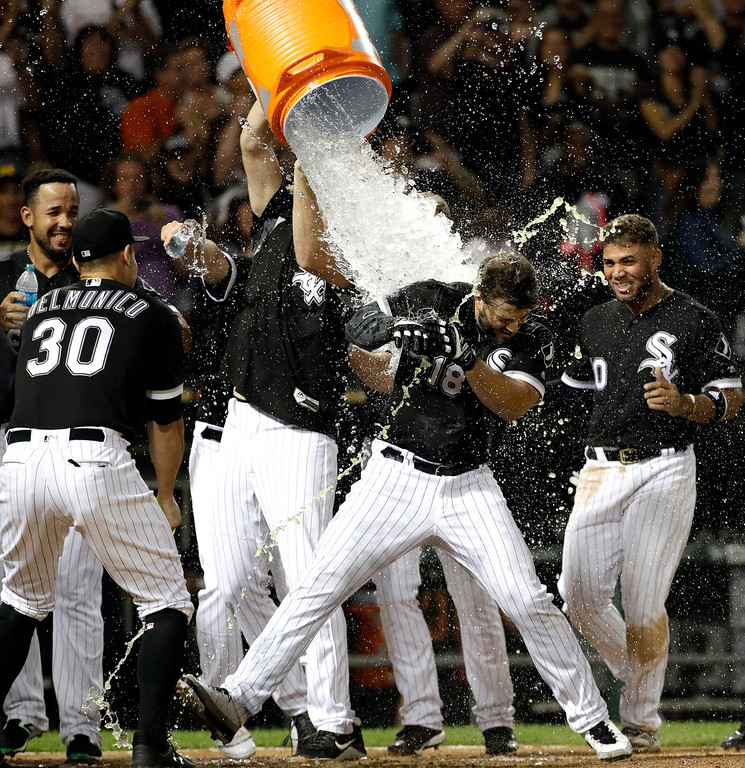 . Chicago White Sox\'s Daniel Palka (18) is doused by teammates after hitting the game-winning solo home run against the Cleveland Indians during a baseball game Friday, Aug. 10, 2018, in Chicago. The White Sox won 1-0. (AP Photo/Nam Y. Huh)