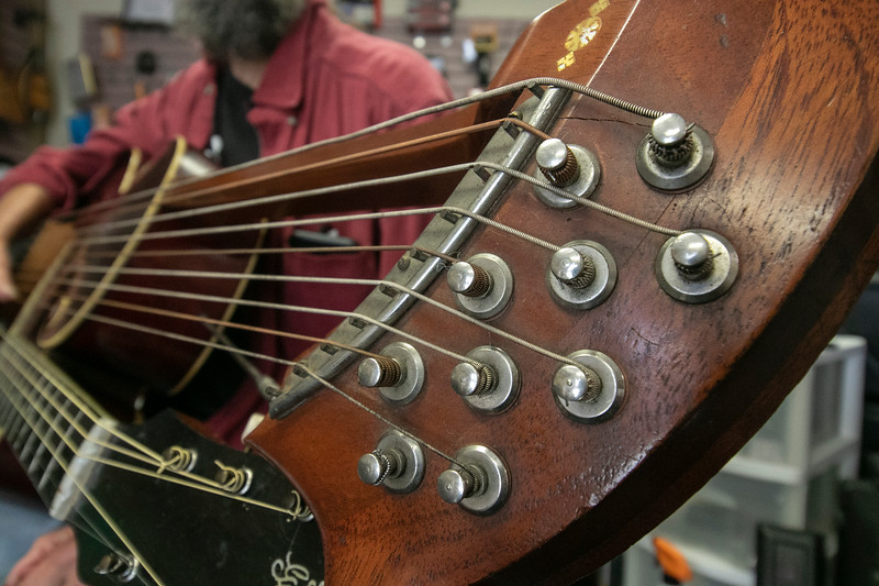 Eddy Troxler the owner of Eddy's Music in Fitchburg shows off the 1918 Gibson U Harp Guitar he just recently got into his shop. This is a close-up of the tuning mechanism for the harp part of the instrument. SENTINEL & ENTERPRISE/JOHN LOVE