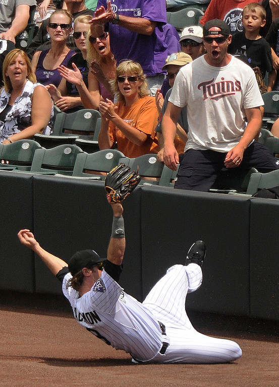 . Colorado outfielder Charlie Blackmon made a sliding catch in foul territory to retire Miami batter Donovan Solano in the second inning. The Colorado Rockies hosted the Miami Marlins at Coors Field Thursday afternoon, July 25, 2013. Photo By Karl Gehring/The Denver Post