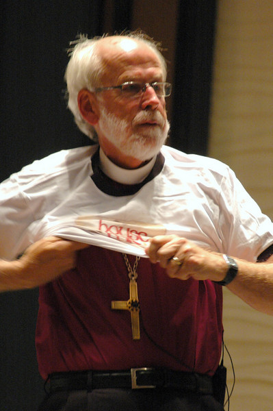 Presiding Bishop Mark S. Hanson dons the House for All Saints and Sinners t-shirt given to him by the Rev. Nadia Bolz-Weber