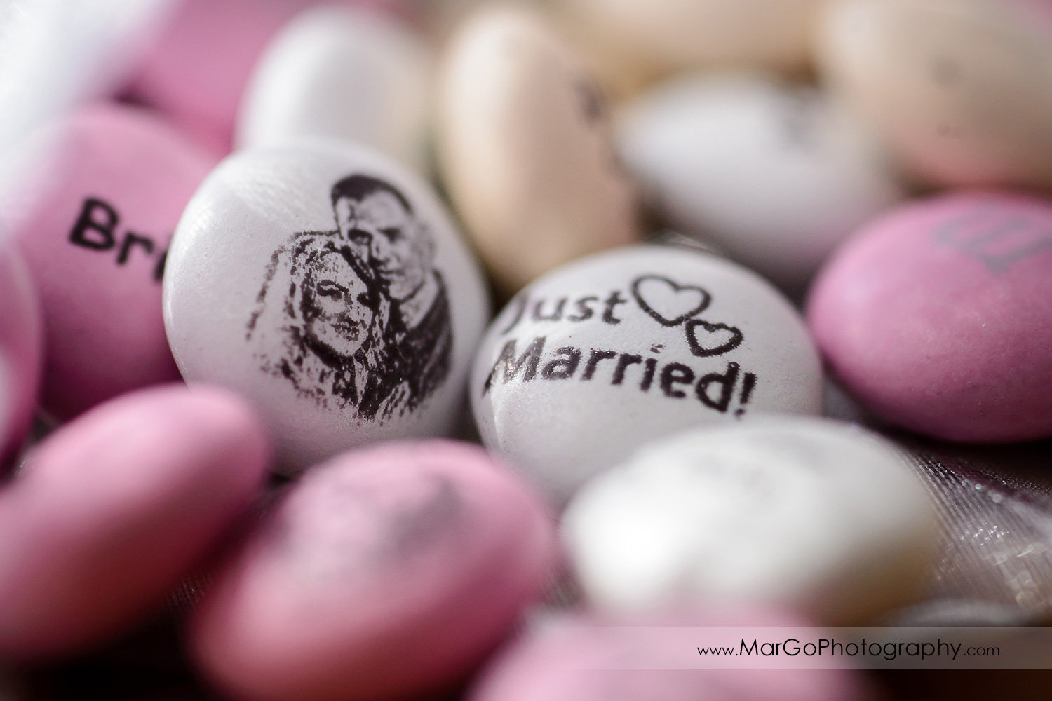white and pink sweets with bride and groom portrait