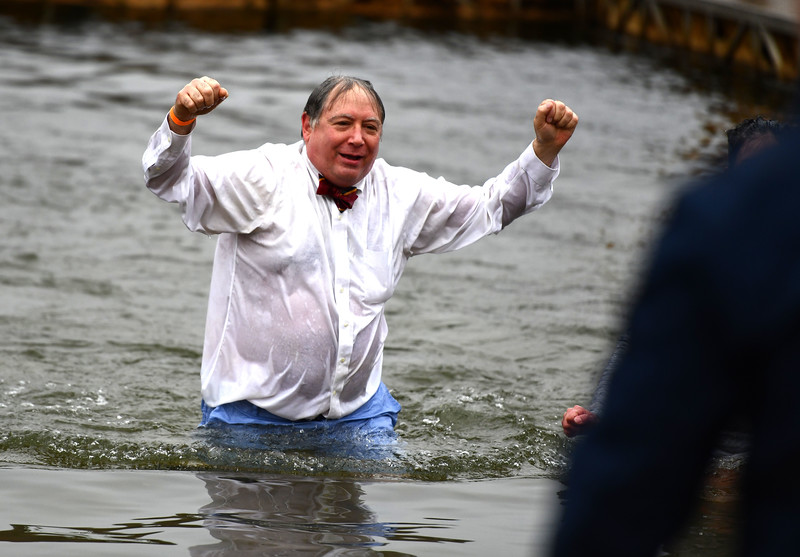 1/18/2020 Mike Orazzi   Staff Plunger Al Natelli during the Annual Camp Sloper Polar Plunge at Sloper Pond in Southington Saturday.