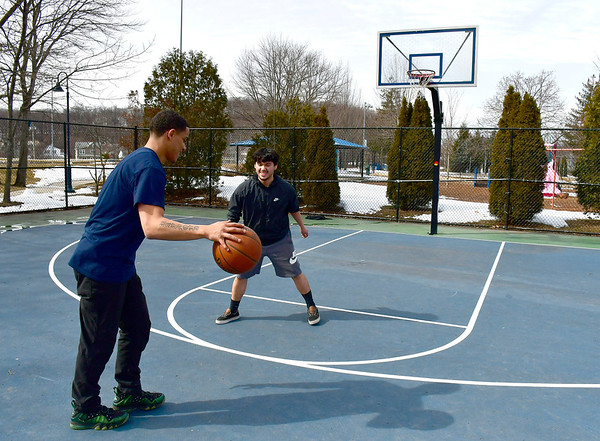 3/12/2019 Mike Orazzi | Staff Ray Rivera and Eric Garcia while playing basketball at Casey Field in Bristol Wednesday.