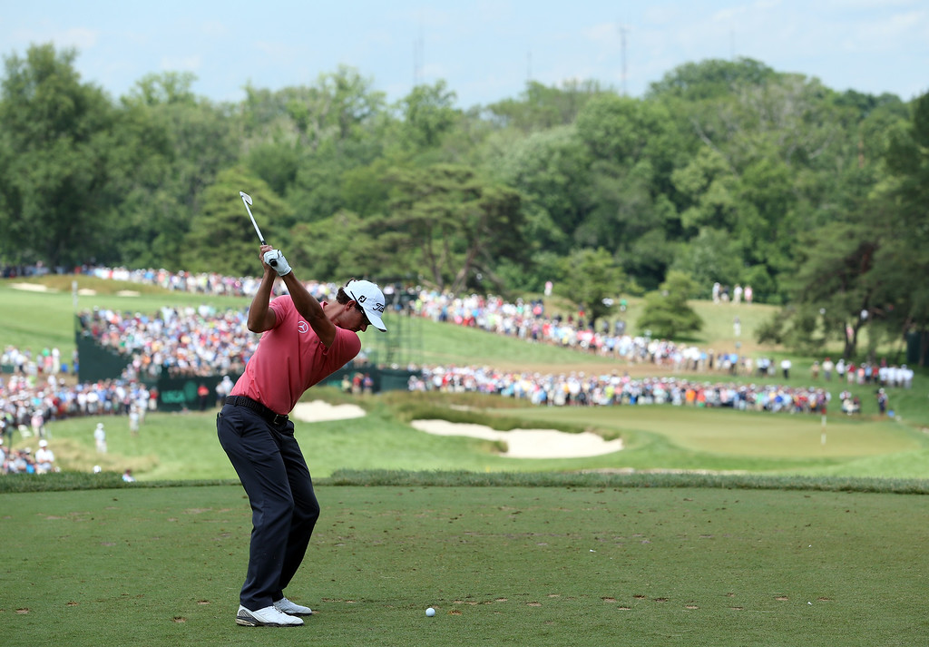 . Adam Scott of Australia hits his tee shot on the ninth hole during Round Two of the 113th U.S. Open at Merion Golf Club on June 14, 2013 in Ardmore, Pennsylvania.  (Photo by Andrew Redington/Getty Images)