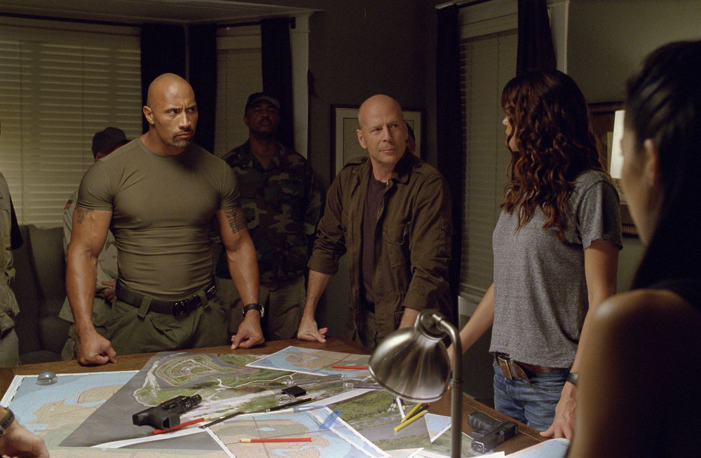 . Dwayne Johnson (left) plays Roadblock and Bruce Willis (center) plays Colton in G.I. JOE: RETALIATION, from Paramount Pictures, MGM, and Skydance Productions. (Jaimie Trueblood/Paramount Pictures)