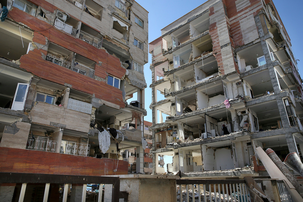 . Buildings are damaged by an earthquake in a compound which was built under the Mehr state-owned program, in Sarpol-e-Zahab in western Iran, Tuesday, Nov. 14, 2017. Iran\'s President Hassan Rouhani says his administration will probe the cause of so much damage to buildings constructed under the Mehr program after a powerful earthquake hit the area along the border with Iraq on Sunday which killed over 400 people. (AP Photo/Vahid Salemi)