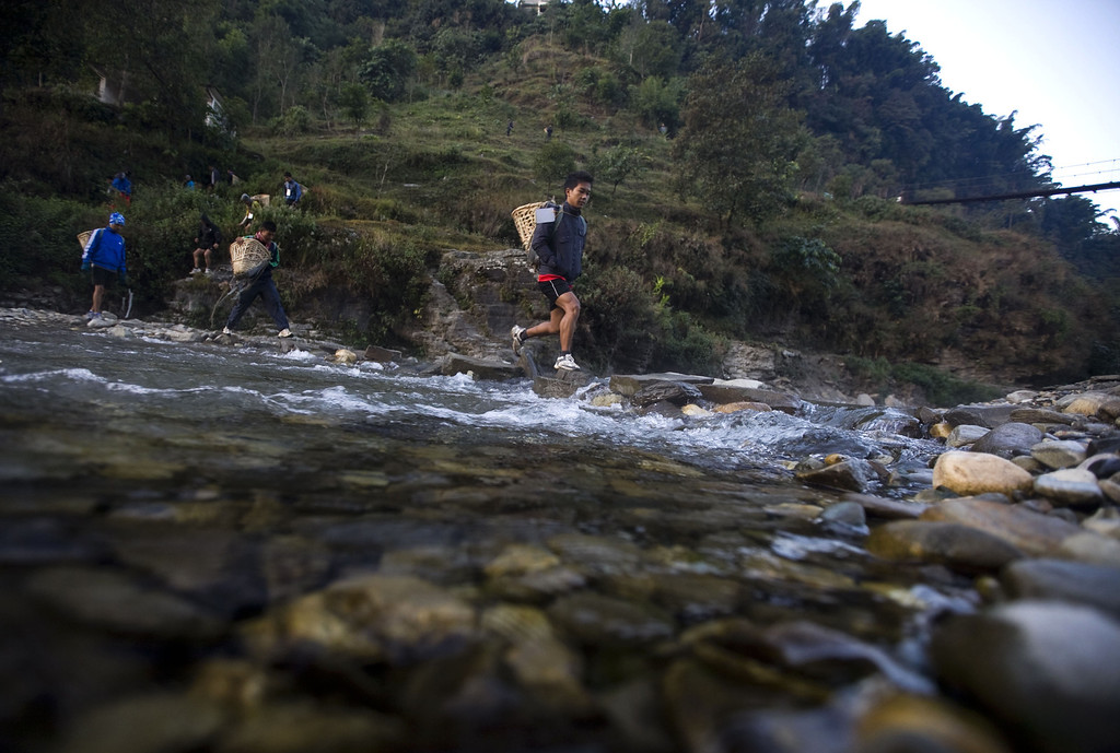 . Nepalese youths cross Kali river as they arrive to take part in a high hill race as part of their physical training session, organized by a private institute in Phokhara who prepares them for the British Gurkha soldier recruitment selection, at Malam Mountain in Kaski district, Nepal, 18 November 2012. The British Gurkha soldier recruitment selection process started on 23 November and runs untill the end of December 2012 at British Gurkha camp situated in Pokhara City, Nepal. Around 125 youths will be selected from more than three thousands participants. Those selected will join the British Army, a selection which carries much prestige and admiration throughout Nepalese society.  EPA/NARENDRA SHRESTHA