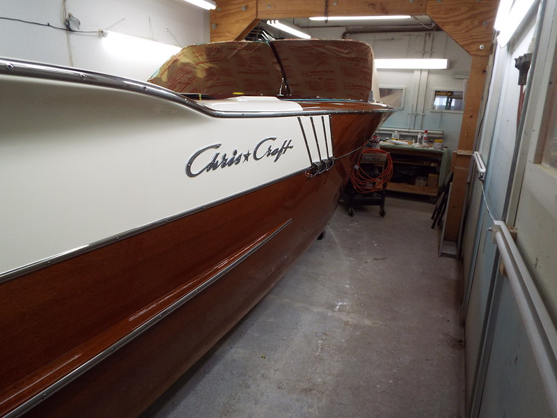Starboard fin with stainless steel trim and moldings installed.