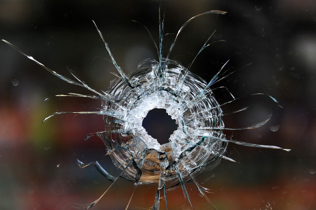 . Bullet holes in the store window of IV Deli Mart in Isla Vista, Saturday, May 24, 2014, which was one of the scenes of Friday night\'s shootings. (Photo by Michael Owen Baker/Los Angeles Daily News)
