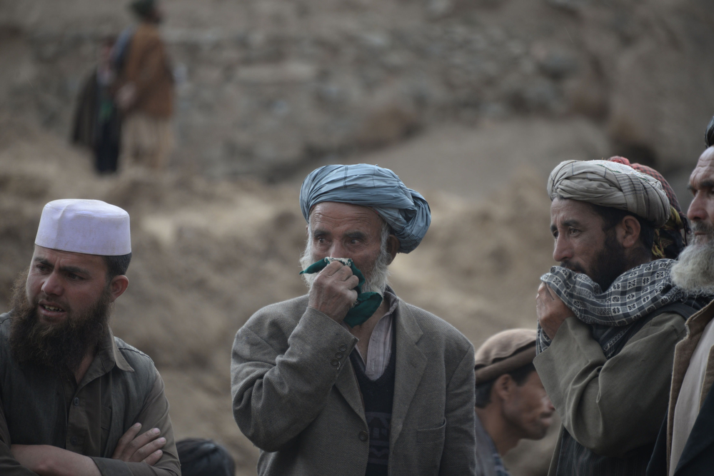. Afghan villagers react at the scene in Argo district of Badakhshan province on May 3, 2014 after a massive landslide May 2 buried a village. Rescuers searched in vain for survivors May 3 after a landslide buried an Afghan village, killing 350 people and leaving thousands of others feared dead amid warnings that more earth could sweep down the hillside. Local people made desperate efforts to find victims trapped under a massive river of mud that engulfed Aab Bareek village in Badakhshan province, where little sign remained of hundreds of destroyed homes. (FARSHAD USYAN/AFP/Getty Images)