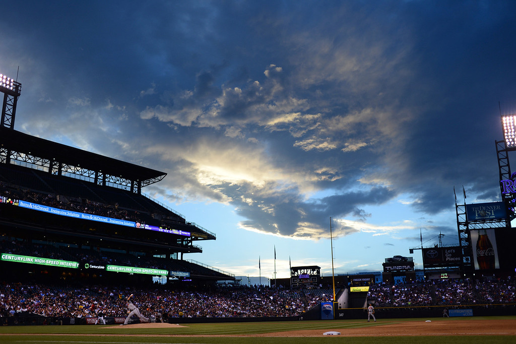 . Atlanta starting pitcher Mike Minor was on the mound as the sun set behind Coors Field Tuesday night. The Colorado Rockies hosted the Atlanta Braves Tuesday night, June 10, 2014. (Photo by Karl Gehring/The Denver Post)