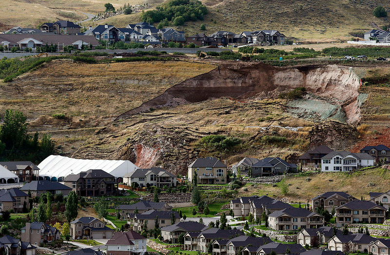 . This Tuesday, Aug. 5, 2014 photo shows the area of a landslide in a hillside community of North Salt Lake, Utah. One home has been destroyed and at least a dozen others have been evacuated. (AP Photo/The Deseret News, Ravell Call)