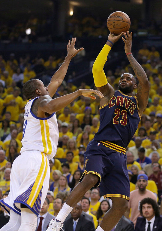 . Cleveland Cavaliers forward LeBron James (23) shoots against Golden State Warriors forward Andre Iguodala (9) during the first half of Game 1 of basketball\'s NBA Finals in Oakland, Calif., Thursday, June 4, 2015. (AP Photo/Ben Margot)