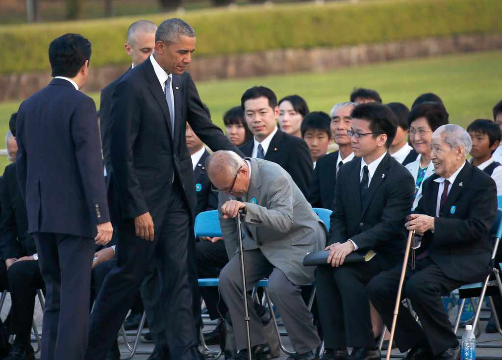 . U.S. President Barack Obama, second from left, greets Shigeaki Mori, an atomic bomb survivor, third from right, and Sunao Tsuboi, right, chairman of Japan Confederation of A-and H-Bomb Sufferers Organizations, during a ceremony at Hiroshima Peace Memorial Park in Hiroshima, western, Japan, Friday, May 27, 2016. Obama on Friday became the first sitting U.S. president to visit the site of the world\'s first atomic bomb attack, bringing global attention both to survivors and to his unfulfilled vision of a world without nuclear weapons. AT left is Japanese Prime Minister Shinzo Abe. (AP Photo/Shuji Kajiyama)