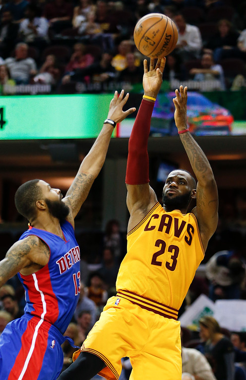 . Cleveland Cavaliers\' LeBron James (23) shoots over Detroit Pistons\' Marcus Morris (13) during the second half of an NBA basketball game Friday, Nov. 18, 2016, in Cleveland. (AP Photo/Ron Schwane)