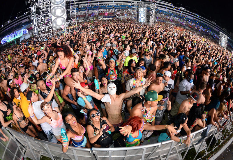 . Fans react as they watch a set by Major Lazer at the 17th annual Electric Daisy Carnival at Las Vegas Motor Speedway on June 23, 2013 in Las Vegas, Nevada.  (Photo by Ethan Miller/Getty Images)