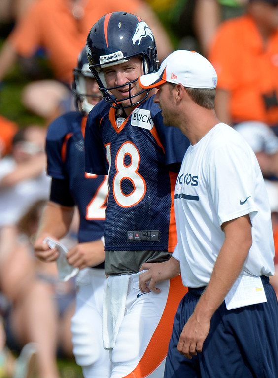 . Denver Broncos QB Peyton Manning (18) talks with Adam Gase Offensive Coordinator during training camp August 1, 2013 at Dove Valley. (Photo By John Leyba/The Denver Post)