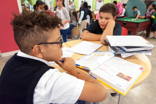09/24/18 Wesley Bunnell | Staff Nick Burgos, age 10 L, works on his math homework at the Bristol Boys and Girls Club on Monday afternoon as friend Eliel Mena, age 11, looks on.