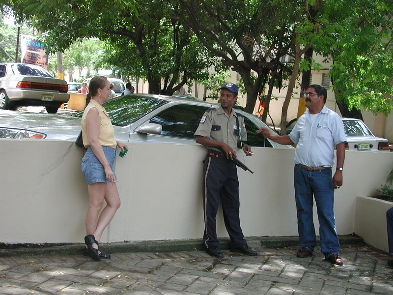 Adele attampts to talk to the Police in Santa Domingo. This city is well protected by police who carry shot guns not hand guns.