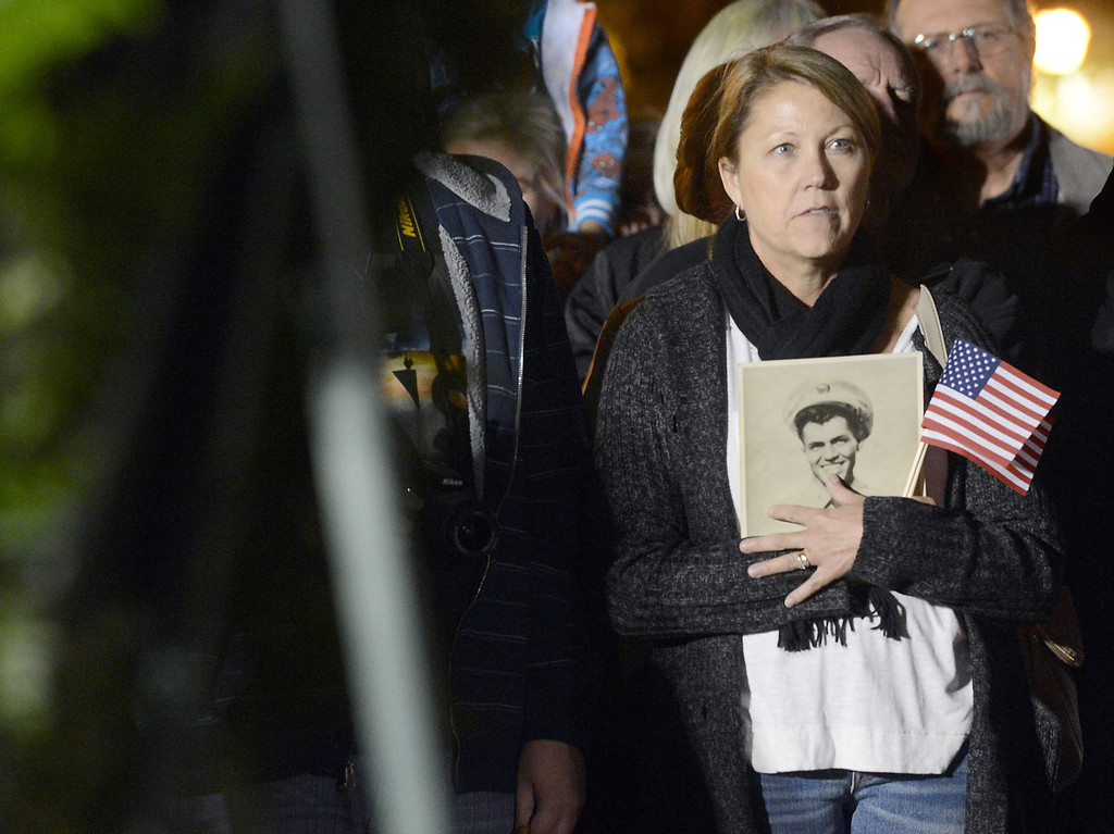 . Judy Turnquist, of San Dimas, holds a photo of her late father, Robert Vanderloop, a Korean War veteran, during the dedication ceremony of the San Dimas H.E.R.O.E.S. Veteran\'s Monument at Freedom Park in San Dimas, CA. Monday, November 11, 2013. (Photo by Jennifer Cappuccio Maher/Inland Valley Daily Bulletin)