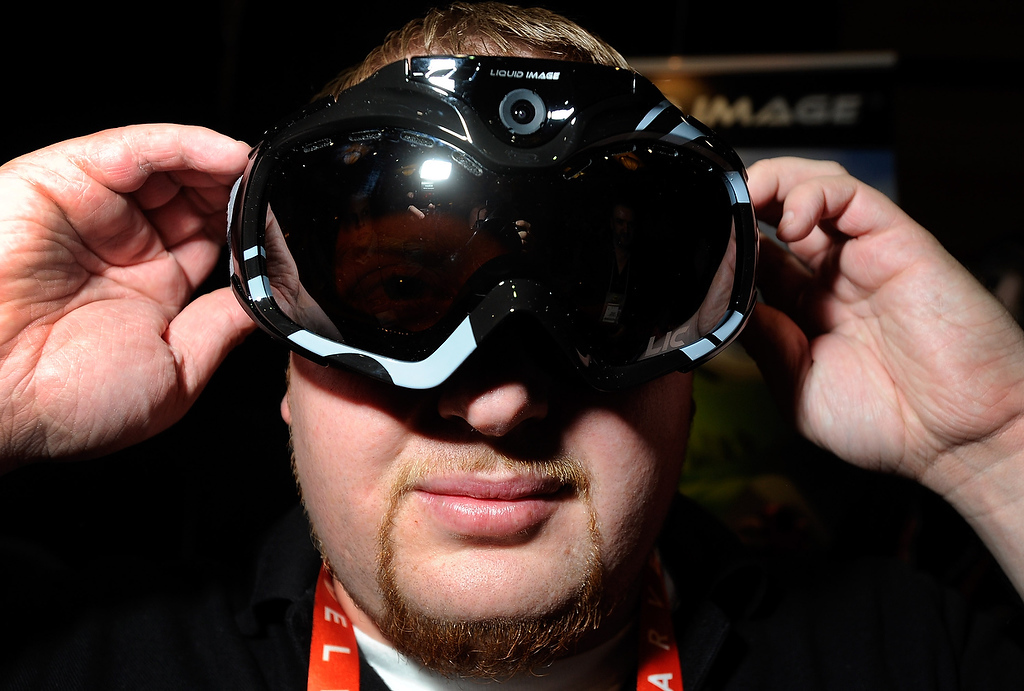 . John Noonan displays a pair of Liquid Image goggles with a built in camera at a press event at the Mandalay Bay Convention Center for the 2013 International CES on January 6, 2013 in Las Vegas, Nevada. The goggles which have built-in WiFi are currently available on the market and have a retail price of USD 399. (Photo by David Becker/Getty Images)