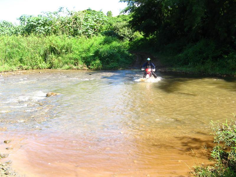 Sa-ngiam crossing a small river.