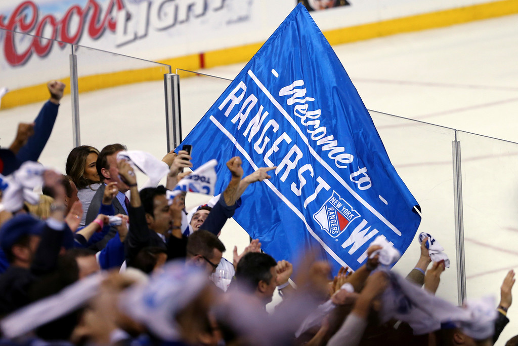 . Fans cheer on the New York Rangers during the game against the Montreal Canadiens in Game Three of the Eastern Conference Final during the 2014 NHL Stanley Cup Playoffs at Madison Square Garden on May 22, 2014 in New York City.  (Photo by Elsa/Getty Images)