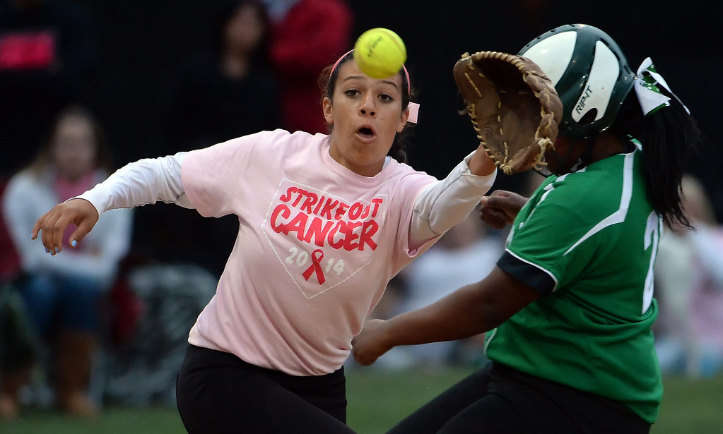 . Monrovia\'s Derek Blow safe at third base as La Canada third baseman Sammy Jedrey waits for the softball in the first inning of a prep softball game at La Canada High School in La Canada, Calif., on Friday, April 25, 2014.  (Keith Birmingham Pasadena Star-News)