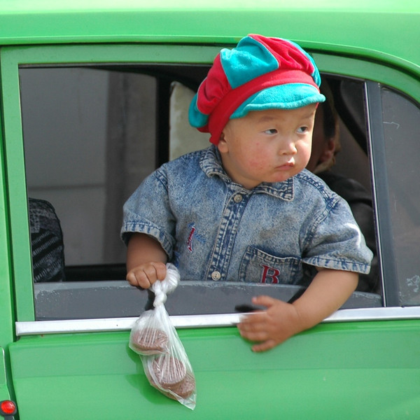 Kyrgyz Boy with Cookies - Karakol, Kyrgyzstan