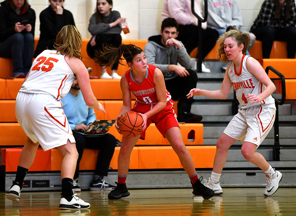 12/26/2019 Mike Orazzi | StaffrTerryville High School's Taylor Barnett (25) and Zoe Zappone (4) along with Northwestern's Natalie Brodnitzki (5) during Thursday's girls basketball game in Terryville.