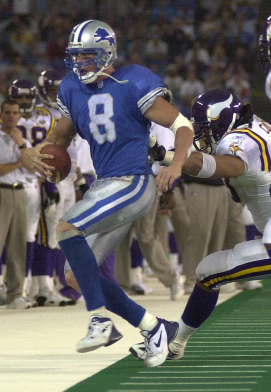 . Detroit Lions QB Mike McMahon scampers out of bounds after a short gain while being chased by Minnesota Vikings Stalin Colinet during the Lions 27-24 win over the Minnesota Vikings at the Pontiac Silverdome Sunday December 16, 2001.