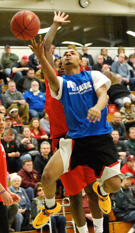 . Jeff Forman/JForman@News-Herald.com Julio Stevens, Blue Team, goes up for a shot during the 36th News-Herald Classic March 29 at Lakeland Community College.