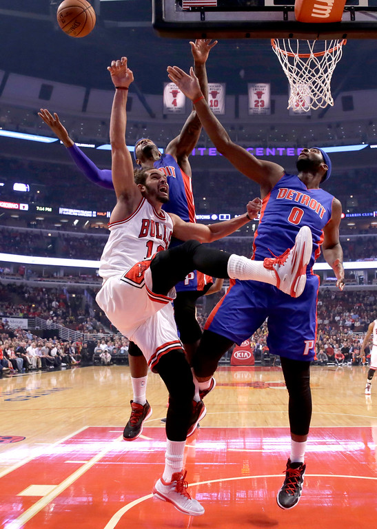 . Detroit Pistons forward Josh Smith, left, and center Andre Drummond, right, block the shot of Chicago Bulls center Joakim Noah (13) during the first half of an NBA basketball game Monday, Nov. 10, 2014, in Chicago. (AP Photo/Charles Rex Arbogast)