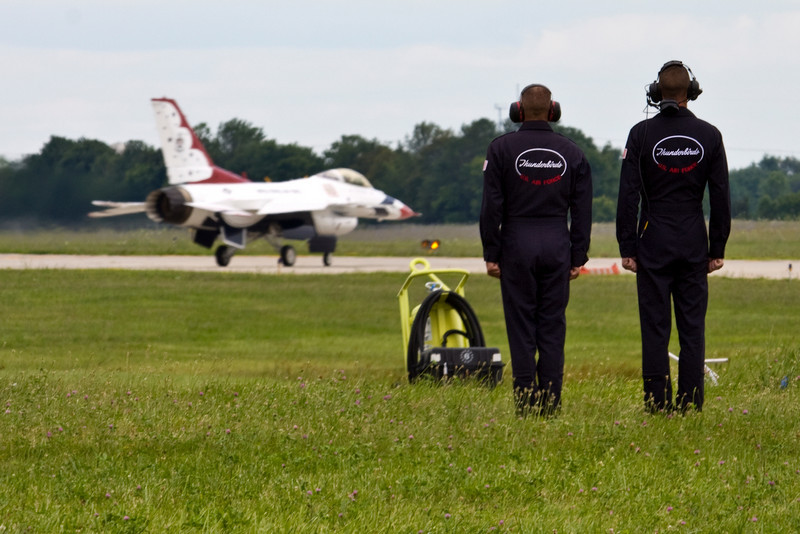 Some of the team standing at attention as the Thunderbirds taxi to the end of the runway.