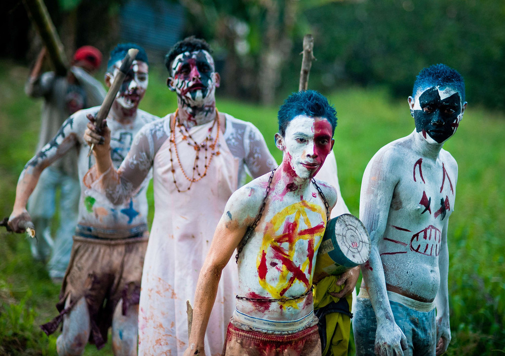 ". Young revellers take part in a parade called ""La Calabiuza\"" on November 1, 2013, on the eve of the Day of the Dead in Tonacatepeque, 20 kms (13 miles) north of San Salvador, El Salvador. During the celebration, the residents of Tonacatepeque, originally an indigenous community, recall the characters of the mythology of Cuscatlan --pre-Columbian west and central regions of El Salvador-- and their dead relatives. Jose CABEZAS/AFP/Getty Images"