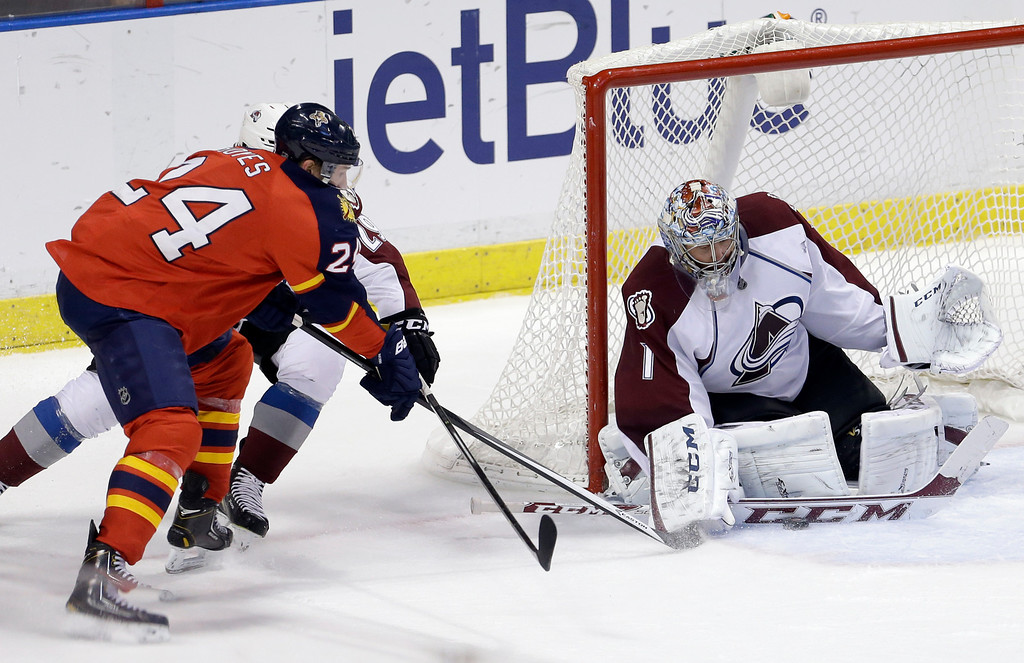 . Colorado Avalanche goalie Semyon Varlamov (1) blocks a shot by Florida Panthers right wing Brad Boyes (24) during the third period of an NHL hockey game in Sunrise, Fla., Friday, Jan. 24, 2014. The Avalanche won 3-2. (AP Photo/Alan Diaz)