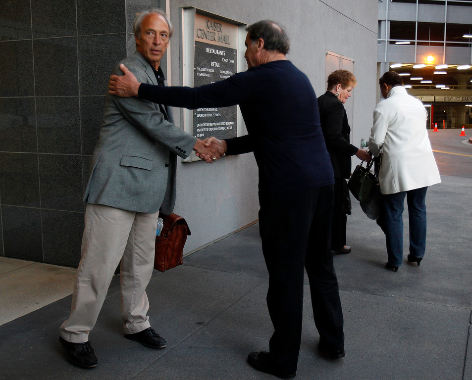 . Tom Hock, lead negotiator shakes hands with an unidentified man, after a BART press conference outside of their offices in downtown Oakland, Calif. on Sunday, Aug. 11, 2013.  (Nhat V. Meyer/Bay Area News Group)