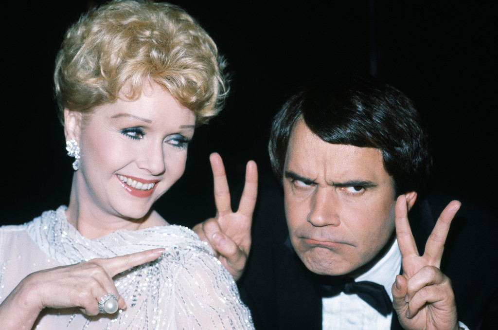 . Actress Debbie Reynolds with comedian Rich Little in Los Angeles on March 20, 1982. (AP Photo/Doug Pizac)